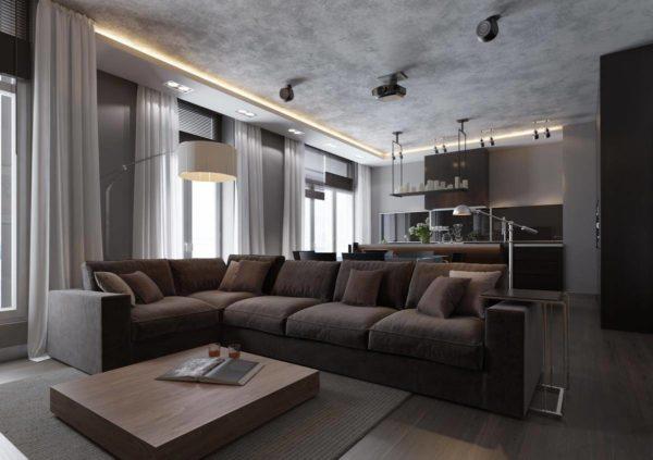 Угловой диван в квартире свободной планировки используется для зонирования пространства